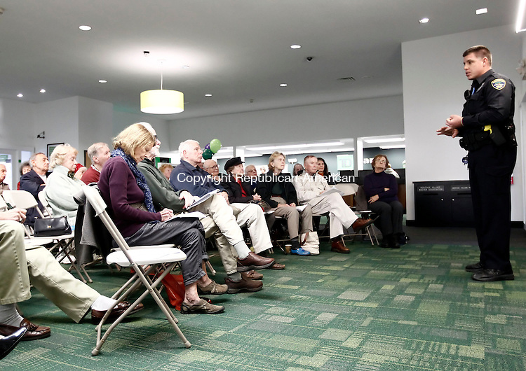 Southbury, CT- 20 November 2013-112013CM02-  Officer Chris O'Toole, with the Southbury Police Department, and Community Resource Officer for the greater Heritage Village area, talks with Southbury residents at TD Bank in Southbury Wednesday afternoon.  O'Toole and representatives from TD Bank were educating the residents on how to protect  themselves from fraud.    Christopher Massa Republican-American