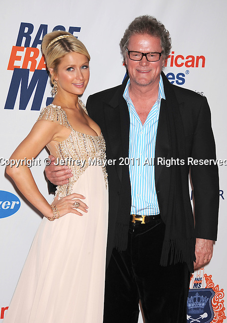 CENTURY CITY, CA - APRIL 29: Paris Hilton and father Rick Hilton arrive at the 18th Annual Race To Erase MS at the Hyatt Regency Century Plaza on April 29, 2011 in Century City, California.