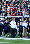 SIOUX FALLS, SD, OCTOBER 8:  University of Sioux Falls head coach Jed Stugart stands at attention during the National Anthem prior to their homecoming game against Southwest Minnesota State University Saturday night at Bob Young Field. (Photo by Dave Eggen/Inertia)