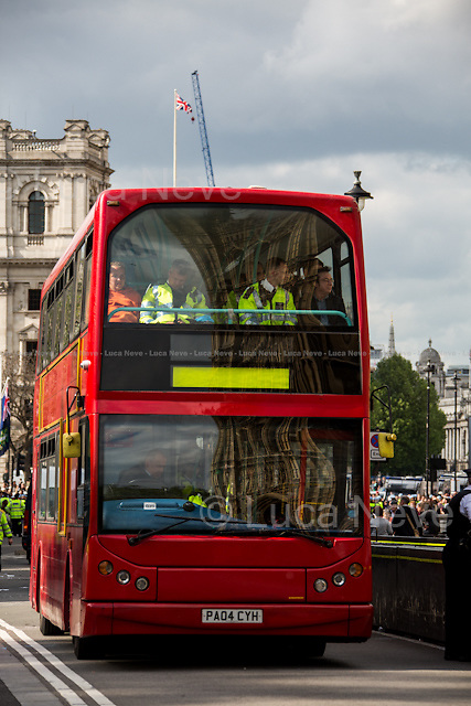 The double-decker bus containing the arrested protesters.<br /> <br /> London, 01/06/2013. UAF (United Against Fascism) held a demonstration outside the Parliament to stop the BNP (British National Party) march. The aim of the far right political party rally was to lay a wreath at the Cenotaph in honour of the soldier Drummer Lee Rigby, victim of the Woolwich attack. The police in riot gears arrested 58 member of UAF under Section 14 of the public order act (1986).
