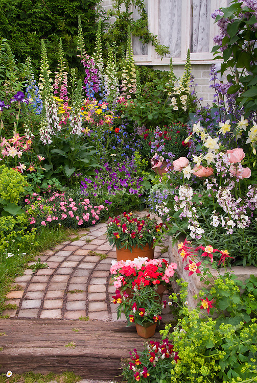 Flower Garden Path stone garden path with lush flower garden | plant & flower stock