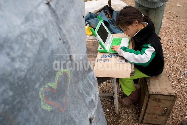 A girl of a recycler´s family that virtually lives in the streets of the poor Montevideo outskirts el Cerro, uses the laptop she got from Plan Ceibal government plan, that gave a portable computer to every kid in the country.