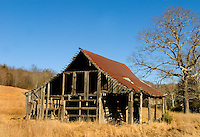 An old barn in a golden-brown field sets a striking figure in the mountains of North Carolina. Photo was taken in Banner Elk, NC.