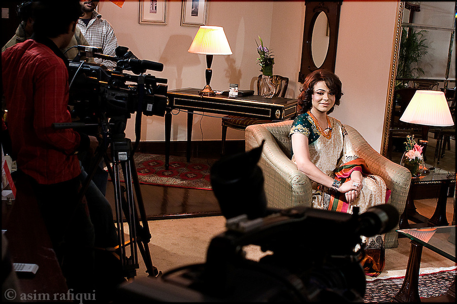Ali Saleem a.k.a. Begum Nawazish, a popular cross-gender tv takl show host, prepares to record a women's day special featuring the human rights activist asma jehangir and educationist salima hashmi
