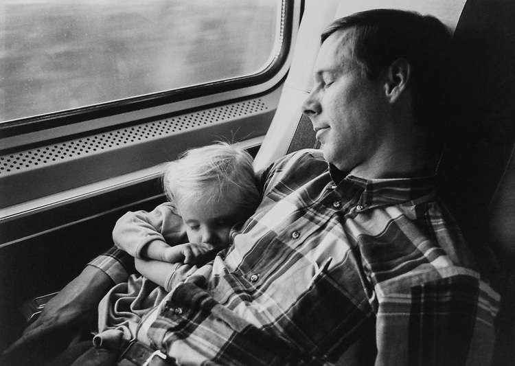 Rep. Fred Upton, R-Mich., with daughter Meg Upton caught napping on the side back to Washington, D.C., on March 21, 1991. (Photo by Laura Patterson/CQ Roll Call via Getty Images)