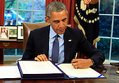 United States President Barack Obama signs H.R. 1314, the Bipartisan Budget Act of 2015 into law in the Oval Office of the White House in Washington, DC on November 2, 2015<br /> Credit: Dennis Brack / Pool via CNP