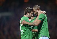 FUSSBALL   1. BUNDESLIGA  SAISON 2011/2012  30. SPIELTAG 10.04.2012 SV Werder Bremen - Borussia Moenchengladbach  JUBEL Werder Bremen; Kopf an Kopf; Torschuetze Naldo (re) mit Sokratis Papastathopoulos
