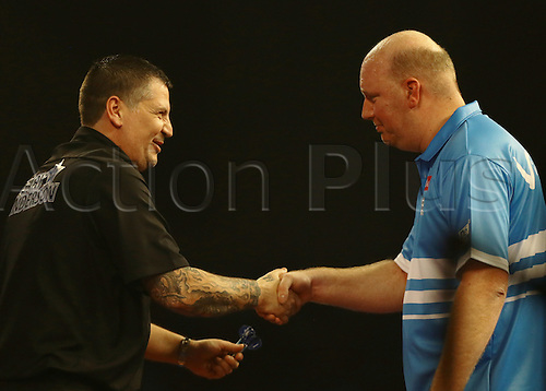29.12.2015. Alexandra Palace, London, England. William Hill PDC World Darts Championship. World Champion Gary Anderson wins the match and shakes hands with Vincent van der Voort