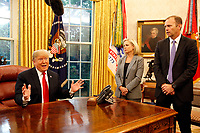 United States President Donald J. Trump, left, meets with Federal Emergency Management Agency (FEMA) Director William Brock Long, right, and US Secretary of Homeland Security (DHS) Kirstjen Nielsen, center, on Hurricane Michael in the Oval Office of the White House, Washington, DC, October 10, 2018.<br /> CAP/MPI/RS<br /> &copy;RS/MPI/Capital Pictures
