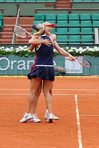 09.06.2013 Paris, France. Ekaterina Makarova of Russia and Elena Vesnina of Russia celebrates their win after the match  against Sara Errani of Italy and Roberta Vinci of Italy in the Women's Doubles Final of the French Open from Roland Garros.