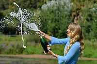 January 28, 2018: The 2018 Australian Open Women's Champion Caroline Wozniacki of Denmark sprays champagne for the media at the Botanical Gardens in Melbourne, Australia. Photo Sydney Low