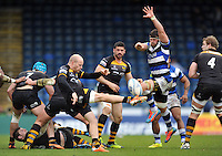 Joe Simpson attempts to box-kick the ball clear as Guy Mercer looks to charge him down. Amlin Challenge Cup semi-final, between London Wasps and Bath Rugby on April 27, 2014 at Adams Park in High Wycombe, England. Photo by: Patrick Khachfe / Onside Images