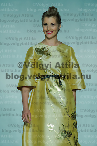Hungarian fashion designer Bori Toth attends a fashion show of her Maison Marquise collection in Budapest, Hungary on May 28, 2013. ATTILA VOLGYI