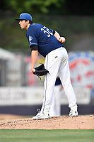 Asheville Tourists starting pitcher Riley Pint (32) looks in for signals during a game against the West Virginia Power at McCormick Field on May 11, 2017 in Asheville, North Carolina. The Power defeated the Tourists 2-1. (Tony Farlow/Four Seam Images)