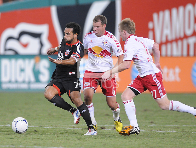 D.C. United forward Dwayne De Rosario (7) goes against New York Red Bulls midfielder Teemu Tainio (6) The New York Red Bulls tied D.C. United 2-2 at RFK Stadium, Wednesday August 29, 2012.