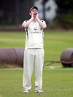 North London captain Jack Atchinson directs his field during the Middlesex County Cricket League Division Three game between North London and Wembley at Park Road, Crouch End on Sat Aug 2, 2014