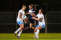 Sky Blue FC midfielder Katy Freels (Frierson) (17) splits a pair of Chicago Red Stars defenders. Sky Blue FC and the Chicago Red Stars played to a 1-1 tie during a National Women's Soccer League (NWSL) match at Yurcak Field in Piscataway, NJ, on May 8, 2013.