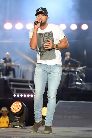 FORT LAUDERDALE FL - APRIL 07: Luke Bryan performs during the Tortuga Music Festival held at Fort Lauderdale Beach on April 07, 2017 in Fort Lauderdale, Florida.  Credit: mpi04/MediaPunch