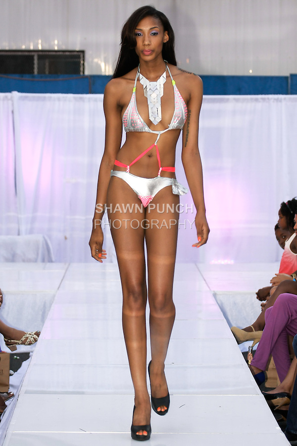 Model walks runway in a Naked Roots Collection swimsuit by Eunika Simmons, during the JRG Bikini Under The Bridge 2012 fashion show on July 9, 2012.
