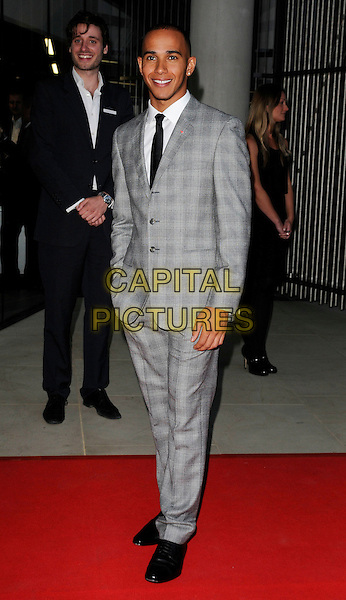 Lewis Hamilton .attending the McLaren Automotive Showroom Launch at One Hyde Park, Knightsbridge, London, England, UK, June 21st 2011..full length  grey gray plaid checked check suit black shoes tie suit white shirt .CAP/CAN.©Can Nguyen/Capital Pictures.