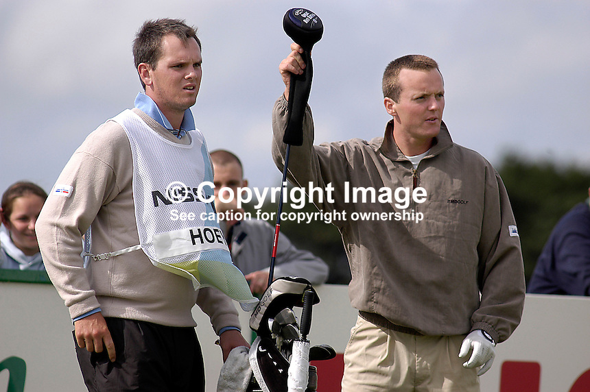 Johnny Foster, caddy, Ballyclare (left) and Michael Hoey, professional golfer, both N Ireland, UK. Taken at Nissan Irish Open, Portmarnock Golf Club, Ireland, in July 2003. Ref: 200307232715...Copyright Image from Victor Patterson, 54 Dorchester Park, Belfast, UK, BT9 6RJ..Tel: +44 28 9066 1296.Mob: +44 7802 353836.Voicemail +44 20 8816 7153.Skype: victorpattersonbelfast.Email: victorpatterson@mac.com.Email: victorpatterson@ireland.com (back-up)..IMPORTANT: If you wish to use this image or any other of my images please go to www.victorpatterson.com and click on the Terms & Conditions. Then contact me by email or phone with the reference number(s) of the image(s) concerned.