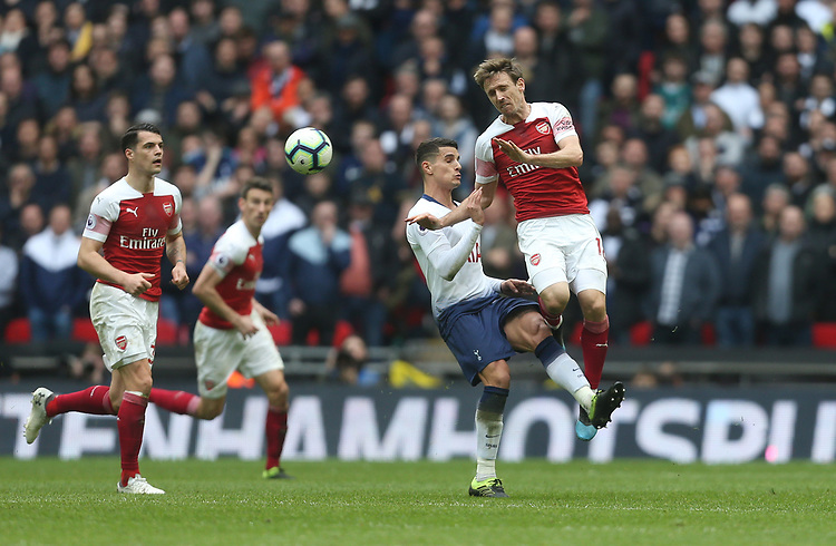 Arsenal's Nacho Monreal and Tottenham Hotspur's Erik Lamela<br /> <br /> Photographer Rob Newell/CameraSport<br /> <br /> The Premier League - Tottenham Hotspur v Arsenal - Saturday 2nd March 2019 - Wembley Stadium - London<br /> <br /> World Copyright © 2019 CameraSport. All rights reserved. 43 Linden Ave. Countesthorpe. Leicester. England. LE8 5PG - Tel: +44 (0) 116 277 4147 - admin@camerasport.com - www.camerasport.com