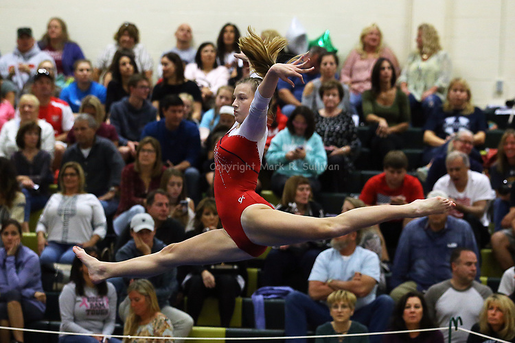 Mary Amen of Manalapan High School works the floor and the air during her floor exericise during the during the Shore Conference Gymnastics 2017 Championships held at Brick Memorial High School in Brick on Saturday October 28, 2017