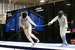 25 MAR 2016:  Ohio State's Alanna Goldie is tagged by Columbia's Jackie Dubrovich in semi final action at the Division I Women's Fencing Championship held at the Gosman Sports and Convention Center in Waltham, MA.Dubrovich went on to defeat Goldie 15-14 in the women's foil event.   Damian Strohmeyer/NCAA Photos