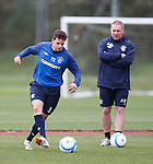 Sebastian Faure watched closely by Ally McCoist