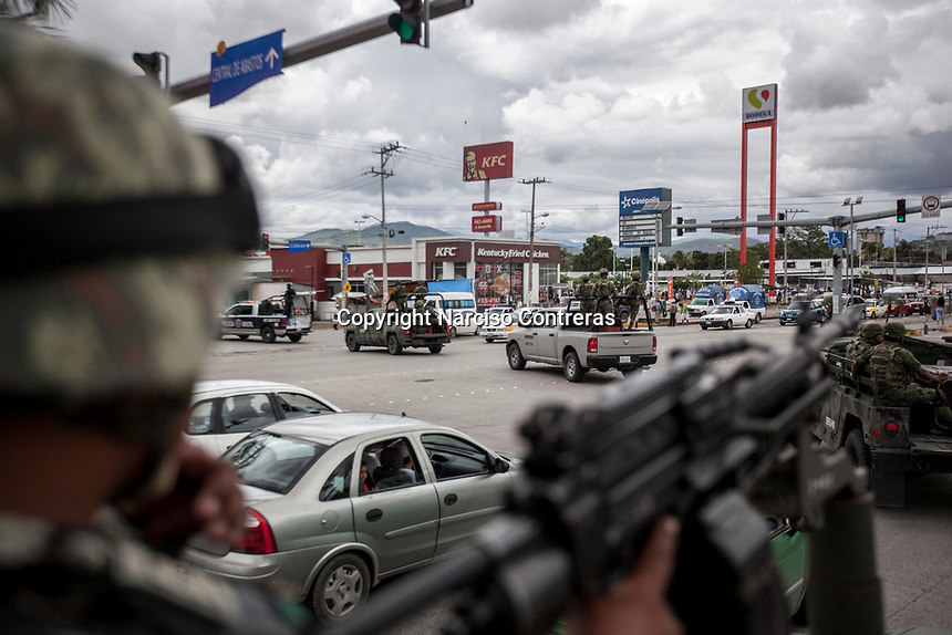 """June 17, 2018: A military convoy surveil """"Zapata/Renacimiento"""" vicinity, a violence-plagued neighbourhoods in Acapulco, Guerrero. A juncture of security forces, among them military, marines, federal police and local police joined under one-command to fight crime violence in the once-glamorous resort destination."""