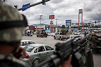 "June 17, 2018: A military convoy surveil ""Zapata/Renacimiento"" vicinity, a violence-plagued neighbourhoods in Acapulco, Guerrero. A juncture of security forces, among them military, marines, federal police and local police joined under one-command to fight crime violence in the once-glamorous resort destination."
