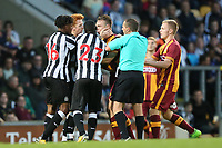 Rolando Aarons of Newcastle United  and Tony McMahon of Bradford City have words during the pre season friendly match between Bradford City and Newcastle United at the Northern Commercial Stadium, Bradford, England on 26 July 2017. Photo by Thomas Gadd.