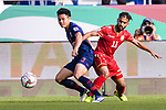 Theerathon Bunmathan of Thailand (L) fights for the ball with Ali Jaafar Madan of Bahrain during the AFC Asian Cup UAE 2019 Group A match between Bahrain (BHR) and Thailand (THA) at Al Maktoum Stadium on 10 January 2019 in Dubai, United Arab Emirates. Photo by Marcio Rodrigo Machado / Power Sport Images