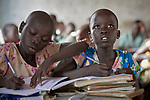 Children in class in the Catholic school in Lugi, a village in the Nuba Mountains of Sudan. The area is controlled by the Sudan People's Liberation Movement-North, and frequently attacked by the military of Sudan. The church has sponsored schools and health care facilities throughout the war-torn region.