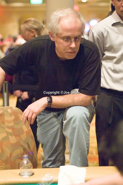 Burt Boutin thinks about calling, does and makes a flush on the river to double up through Bill Edler