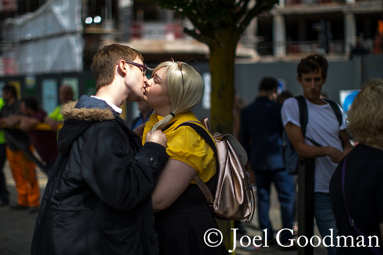 © Joel Goodman - 07973 332324. 30/07/2017 . Manchester , UK . A couple kiss at the entrance to the venue . Cosplayers, families and guests at Comic Con at the Manchester Central Convention Centre . Photo credit : Joel Goodman