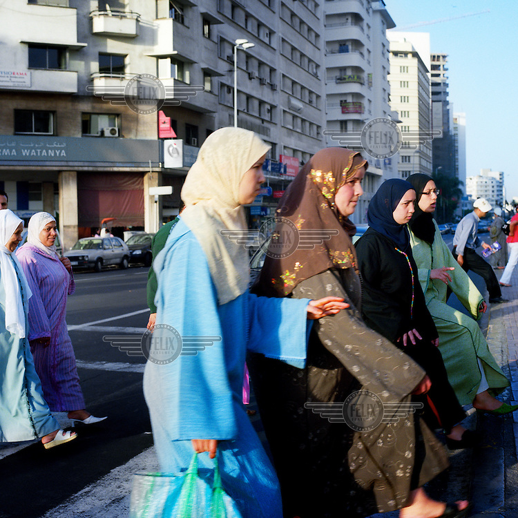 A group of women walk through the streets of Casblanca.