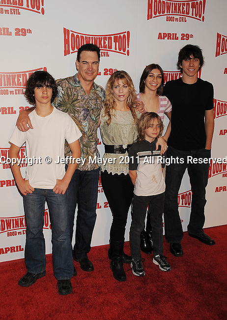 "LOS ANGELES, CA - APRIL 16: Patrick Warburton and family arrive at ""Hoodwinked Too! Hood Vs Evil"" Los Angeles premiere at Pacific Theatres at The Grove on April 16, 2011 in Los Angeles, California."