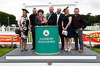 Connections of Red Dragon receive their trophy from Sponsors after winning the Dartmouth General Contractors Ltd Handicap (Div 1),  during Afternoon Racing at Salisbury Racecourse on 7th August 2017