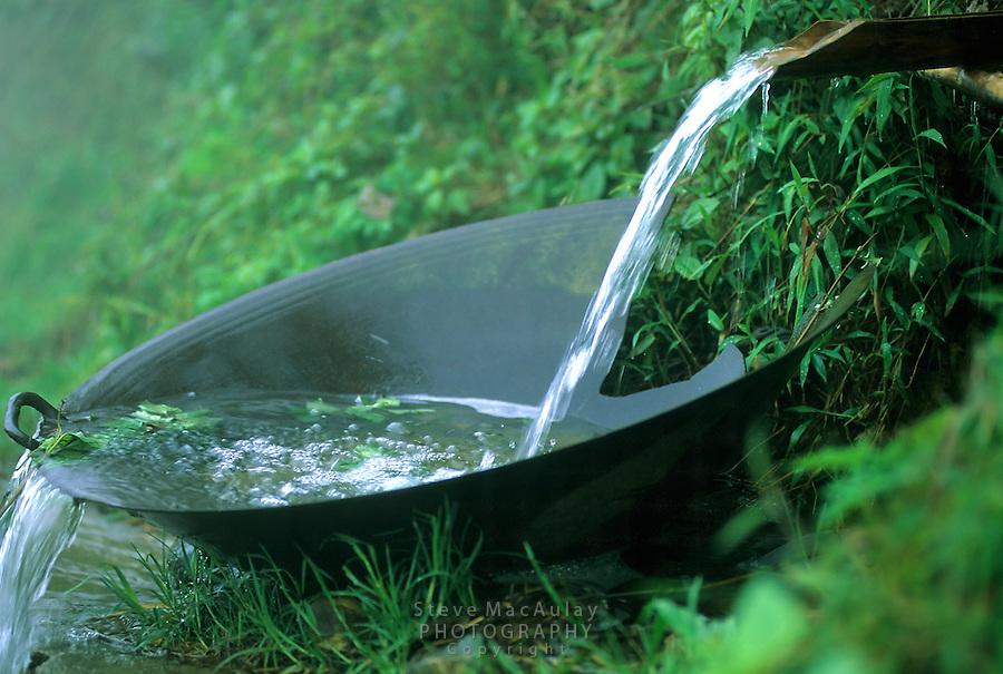 Broken wok creatively used as water diverter in simple, traditional irrigation sysytem, Sapa, Vietnam