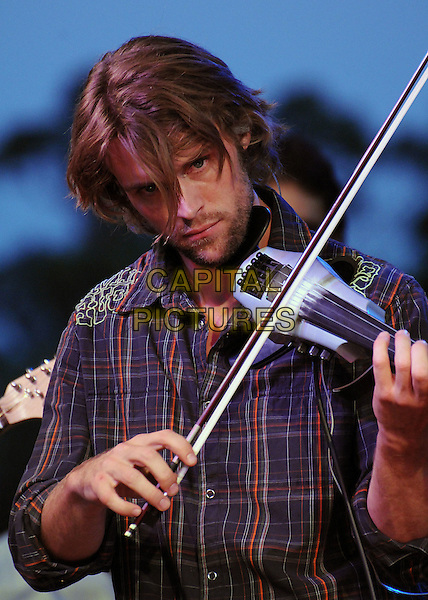 "JESSE SPENCER .""Band From TV"" Free Concert and Screening at the Autry National Center of the American West, Los Angeles, California, USA..August 9th, 2008.half length check checkered plaid shirt violin music stubble facial hair .CAP/ADM/BP.©Byron Purvis/AdMedia/Capital Pictures."