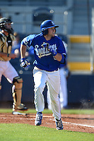 Indiana State Sycamores infielder Derek Hannahs (5) runs to first during a game against the Vanderbilt Commodores on February 21, 2015 at Charlotte Sports Park in Port Charlotte, Florida.  Indiana State defeated Vanderbilt 8-1.  (Mike Janes/Four Seam Images)
