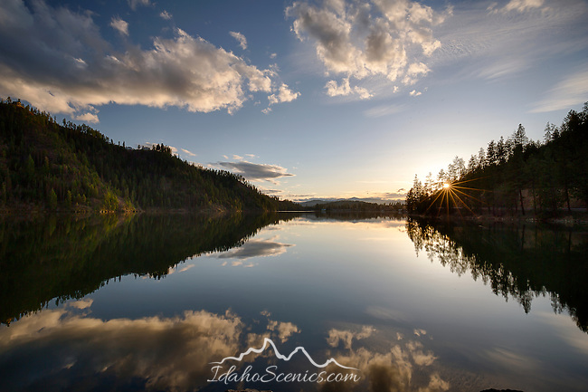 Idaho, North, Kootenai County, Coeur d'Alene. Fernan Lake at sunset in spring.
