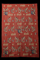 Tapestry of Guigone de Salins, with the motto of Nicolas Rolin, Seulle and a star, coat of arms, N and G initials and a bird on a branch, 15th century, in Les Hospices de Beaune, or Hotel-Dieu de Beaune, a charitable almshouse and hospital for the poor, built 1443-57 by Flemish architect Jacques Wiscrer, and founded by Nicolas Rolin, chancellor of Burgundy, and his wife Guigone de Salins, in Beaune, Cote d'Or, Burgundy, France. The hospital was run by the nuns of the order of Les Soeurs Hospitalieres de Beaune, and remained a hospital until the 1970s. The building now houses the Musee de l'Histoire de la Medecine, or Museum of the History of Medicine, and is listed as a historic monument. Picture by Manuel Cohen