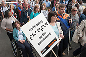 We're being shafted by the government!.  Braille placard at The Hardest Hit  London march organised by the UK Disabled People's Council to protest at government cuts to disability benefits, allowances and services.