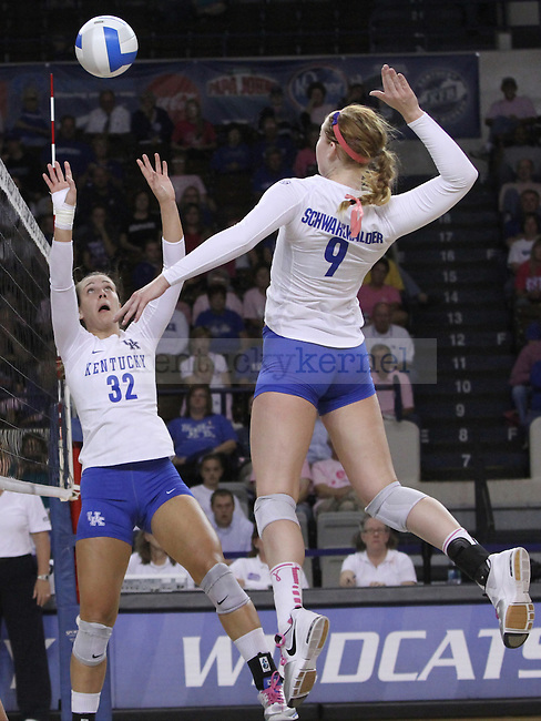 Senior Setter Christine Hartmann (22) set for Freshman Middle Blocker Sara Schwarzwalder (9) during the University of Kentucky vs. Texas A&M volleyball match at Memorial Coliseum in Lexington, Ky., on Sunday, October 14, 2012. Photo by Jared Glover | Staff