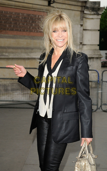 JO WOOD.Lulu Guinness' 20th Anniversary Party at the Victoria and Albert Museum, London, England..June 8th, 2009.V&A V & A half length black white cardigan top leather hand pointing jacket gold bag purse scarf .CAP/CAN.©Can Nguyen/Capital Pictures.