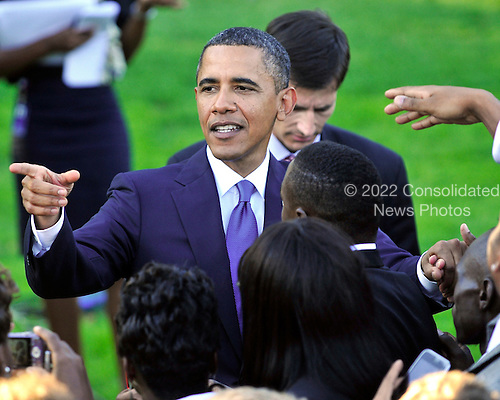 United States President Barack Obama points as he shakes hands after delivering remarks to NCAA Champion Student Athletes on the South Lawn of the White House in Washington, D.C. on Monday, September 13, 2010..Credit: Ron Sachs / CNP.(RESTRICTION: NO New York or New Jersey Newspapers or newspapers within a 75 mile radius of New York City)