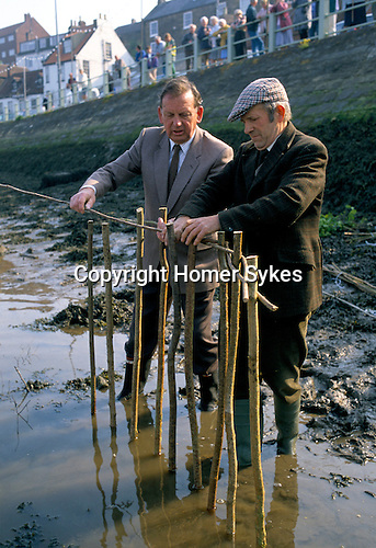 Whitby Penny Hedge. Whitby Yorkshire UK.<br /> Mr Alan Reynolds the horn blower wearing cap.On right Mr Harry Green, the Fyling Court Leet bailiff