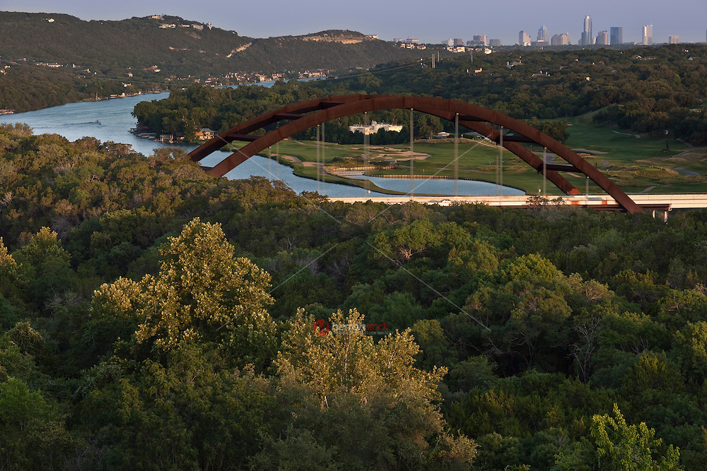 The 360 Bridge in West Austin overlooking the Downtown Austin Skyline and lake-side golf course in between